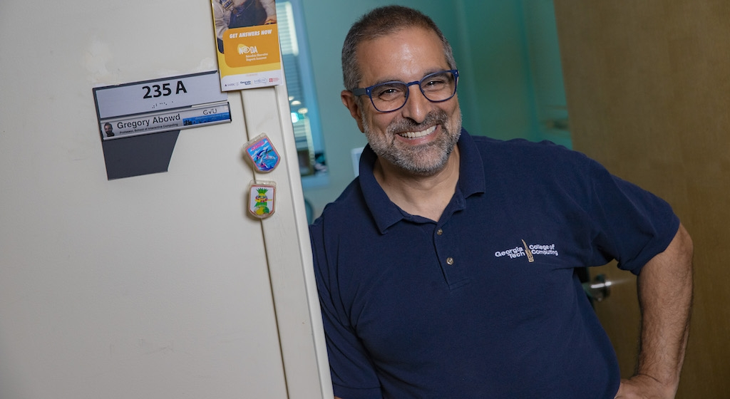 Gregory Abowd standing by his office door smiling