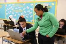 White assists a student in her AP Computer Science course at Mays High School in Atlanta, Ga.