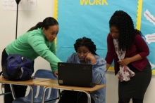 Shana White, Constellations Fellow, collaborates with Ms. Smith, the teacher of record at Mays High School when assisting a student in their AP Computer Science course.